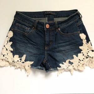 Denim shorts with lace detail.